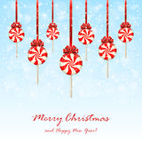 Christmas lollipops with bow on snowy background Stock Photo