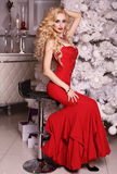 Christmas look, gorgeous woman posing in room with Christmas decorations Stock Photo