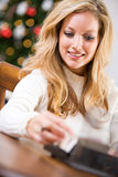Christmas: Looking Up Addresses For Cards Royalty Free Stock Image