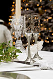 Christmas Love. Wedding champagne glasses in front of a gaily lit Christmas tree Stock Images