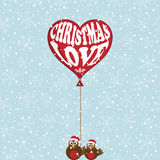 Christmas love. Snowflake background with robins holding christmas balloon Royalty Free Stock Photo