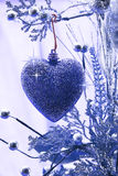 Christmas love. Heart ornament hanging on a branch Royalty Free Stock Photo