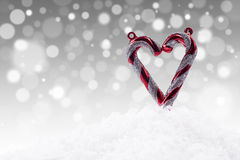 Christmas love on defocused lights background Stock Photos