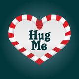 Christmas Love - Hug Me. A fun christmas candy cane in a heart shape. As it's around the theme of love, I added the words 'Hug Me Royalty Free Stock Image