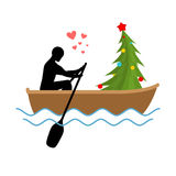 Christmas Lover. Man and Christmas tree ride in boat. Lovers of Stock Photo