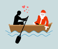 Christmas Lover. Man and Santa Claus and ride in boat. Lovers of Royalty Free Stock Photos