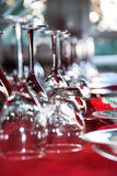 Christmas lunch. Crystal glasses on red tablecloth Stock Photo
