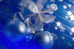 Christmas magic. Celebratory blue glass balls and mysterious light from below Stock Photo