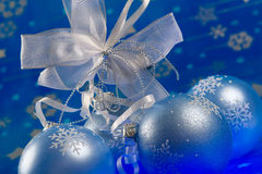 Christmas magic. Celebratory blue glass balls and mysterious light from below stock photos