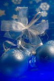 Christmas magic. Celebratory blue glass balls and mysterious light from below Stock Photography