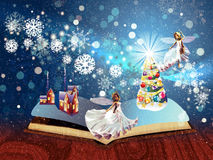 Christmas Magic Book. Opened magic book with decorated christmas tree, houses, snowflakes Royalty Free Stock Photos