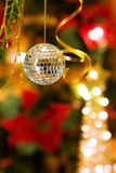 Christmas magic with disco ball decoration. And golden ribbons Royalty Free Stock Images
