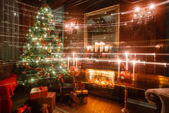 Christmas magic and fairy tale evening by candlelight. classic apartments with a white fireplace, decorated tree, sofa Stock Photo