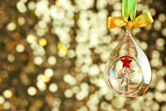 Christmas magic light background with glass bauble and colorful. Ribbon - copy space for text Royalty Free Stock Image
