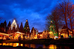 Christmas magic in park by night. Enchantingly decorated park with buildings, lighted by night. Christmas spirit in Europa Park Germany Stock Images