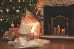 Christmas, magic, people concept - happy child. Opens the magic box with a gift Royalty Free Stock Images