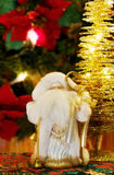 Christmas magic with Santa Claus and golden tree. Celebrating the magic Christmas with Santa Claus and festive tree of golden lights. Over defocused decorations Stock Photo
