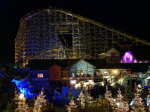 Wooden roller coaster scenery by night in holiday season. Christmas magic in the Icelandic themed area in Europa Park Rust, Germany. The gigantic wooden roller Stock Photo