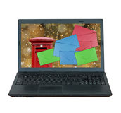Christmas mail, email. Laptop computer. UK letter box. Isolated. Royalty Free Stock Image