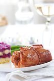 Christmas main course meat casserole. Stuffed meat tied with a string for Christmas dinner Stock Photography