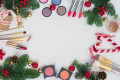 Christmas make up cosmetics. Set of Christmas make up cosmetics products frame with copy space Stock Images
