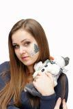 Christmas makeup. A young girl with a beautiful holiday makeup face-art Royalty Free Stock Image