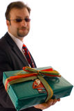 Christmas man. An image of an business man holding a gift box Stock Photography