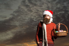 Christmas man with balls in basket Stock Image