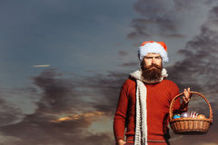 Christmas man with balls in basket Royalty Free Stock Image