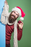 Christmas man with decorative ball Royalty Free Stock Images