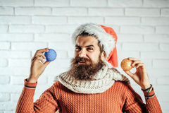 Christmas man with decorative balls Stock Photography
