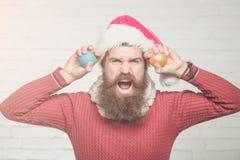 Christmas man with decorative balls Stock Photo