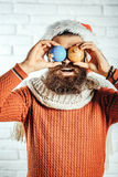 Christmas man with decorative balls Royalty Free Stock Photography