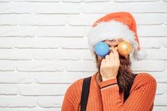 Christmas man with decorative balls Stock Image