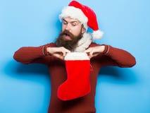 Christmas man with decorative stocking stock photo