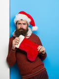 Christmas man with decorative stocking stock images