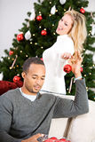 Christmas: Man Helping Woman Decorate Christmas Tree Stock Photo