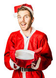 Christmas man holding empty cooking plate Royalty Free Stock Images