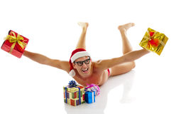 Christmas man laughs and holds gifts Royalty Free Stock Photography