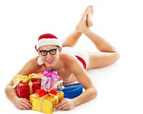 Christmas man laughs and holds gifts Stock Photo