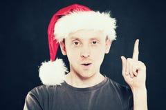 Christmas Man Pointing. Gay in Santa Hat Stock Images