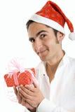 Christmas man with present Stock Image