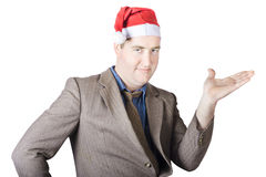 Christmas man showing copyspace gifts and presents Stock Image