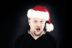 Christmas Man. Smiling Man in Santa Hat Stock Image