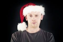 Christmas Man. Smiling Man in Santa Hat Stock Images
