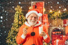 Christmas man in snow. Santa Claus takes a cookie on Christmas Eve as a thank you gift for leaving presents. Cookies for