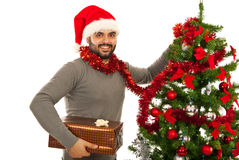 Christmas man with tree and gift Stock Images