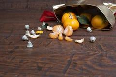 Christmas mandarin orange pouring out of   sack Stock Photo
