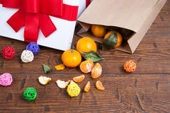 Christmas mandarin orange pouring out of  vintage paper sack Stock Image