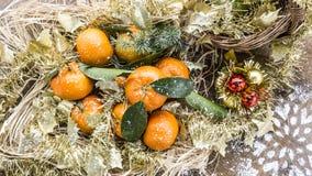 Christmas mandarines with snowflake Royalty Free Stock Photos